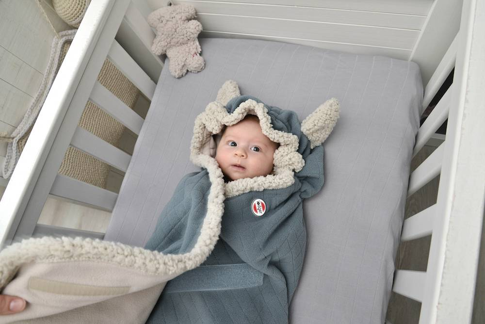 Wrapper_588Ocean_with-baby-in-bed_liggend