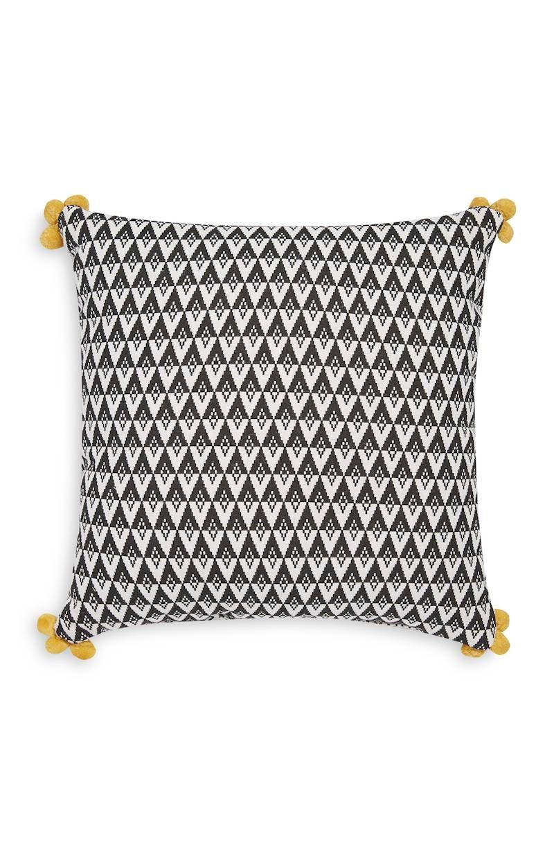 Primark_SS18_homeware_Pom Pom Ornament Cushion White Black, £3 €4 €5